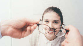 Happy woman trying her new glasses Royalty Free Stock Photo