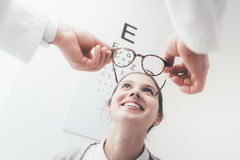 Happy woman trying her new glasses Stock Images