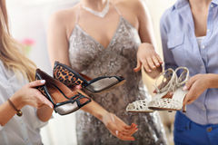 Happy woman trying to choose shoes. Picture of happy women trying to choose shoes in store Royalty Free Stock Photos