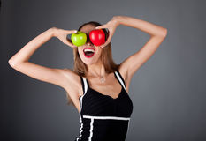 Happy woman with two apple Royalty Free Stock Images