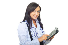 Happy woman type on calculator Stock Image