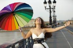 Happy woman with umbrella Stock Photography