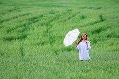 Happy woman with umbrella. Stock Photography