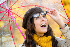 Happy woman with umbrella in autumn Royalty Free Stock Photography