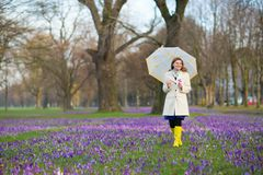 Happy woman with umbrella outdoors Stock Images