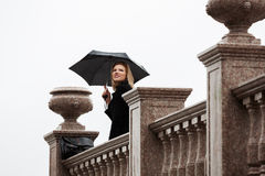 Happy woman with umbrella in the rain Royalty Free Stock Photos