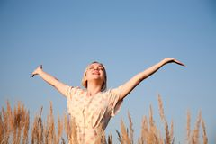 Happy woman under the blue sky Royalty Free Stock Photos