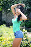 Happy woman is under the rain. Happy smiling woman is under the rain Stock Photos