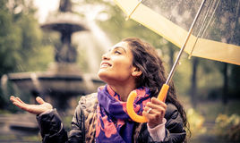 Happy woman under the rain Stock Photos