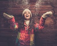 Happy woman under snow Stock Images