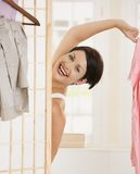 Happy woman undressing Royalty Free Stock Photography