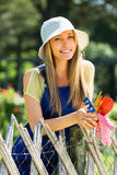 Happy woman  in uniform at yard gardening Stock Photo