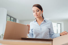 Happy woman unpacking Royalty Free Stock Image