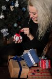 Happy Woman near the New Year Tree with Gifts. Lifestyle royalty free stock images