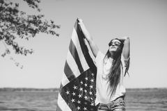 Happy woman with usa flag royalty free stock photo
