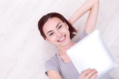 Happy woman use tablet pc Royalty Free Stock Photography