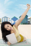 Happy woman uses tablet at shore Royalty Free Stock Photography