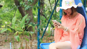 Happy Woman using an app on her smart phone. stock footage