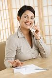 Happy woman using calculator Stock Photos