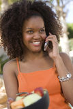Happy Woman Using Cell Phone Stock Photo