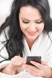 Happy Woman Using Cell Phone Stock Photography