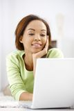 Happy woman using computer Royalty Free Stock Image