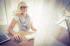 Happy woman using computer Stock Image