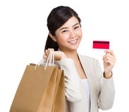 Happy woman using credit card for shopping Royalty Free Stock Photos