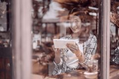 Happy woman using digital tablet in cafe royalty free stock images