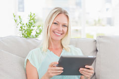 Happy woman using digital tablet Royalty Free Stock Image