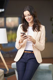 Happy woman using her cellpone Stock Image