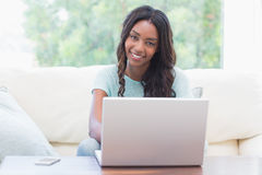 Happy woman using her laptop Royalty Free Stock Photography
