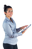 Happy woman using her tablet Royalty Free Stock Photos