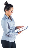 Happy woman using her tablet Stock Images