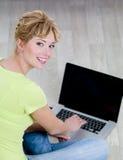 Happy woman using laptop Royalty Free Stock Image