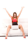 Happy woman using laptop Stock Photo