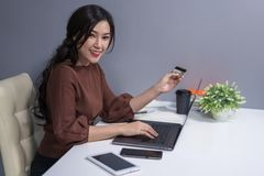 happy woman using laptop computer for online shopping with credit card stock photos