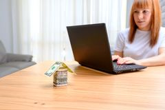 Happy woman using laptop. Concept of buying a home, real estate activity, meeting with advisor, new homes. royalty free stock photo