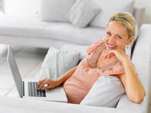 Happy woman using a laptop at home Royalty Free Stock Photo