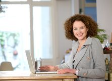 Happy woman using laptop at home Royalty Free Stock Images