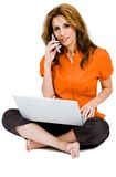 Happy woman using a laptop and mobile Royalty Free Stock Image