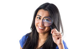 Happy woman using a magnifying glass Stock Image