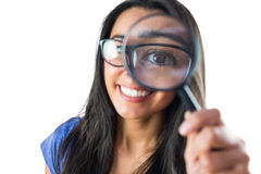 Happy woman using a magnifying glass Royalty Free Stock Photo