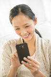 Happy Woman Using Mobile Phone Royalty Free Stock Photography