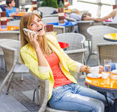 Happy Woman Using Mobile Phone Stock Photography