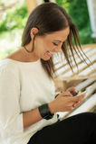 Happy woman using mobile phone Royalty Free Stock Image