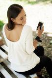 Happy woman using mobile phone Royalty Free Stock Photos