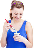 Happy woman using a paintbrush