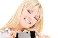 Happy woman using phone camera Stock Images
