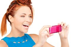 Happy woman using phone camera Stock Photography